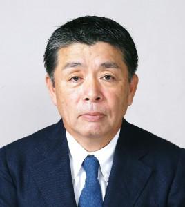 西村会長(写真)